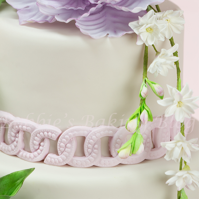 Learn how arrange beautiful  sugar paste flowers for wedding cakes