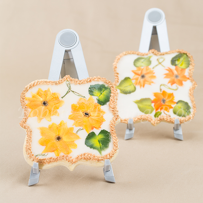 Learn how hand paint sunflowers on a sugar cookie: step by step donna dewberry style video