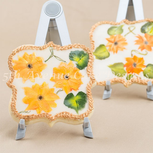 One stroke hand painted sunflowers on a sugar cookie