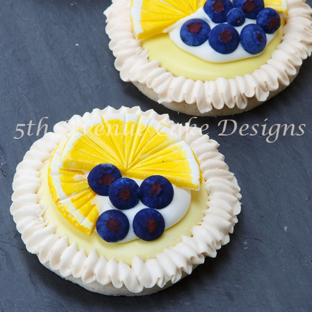 Learn how to make Lemon Meringue Cookies with Royal Icing blueberries and lemon slices!