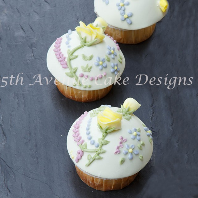 Learn how to pie a rose and flowers with royal icing directly on a cupcake with ease