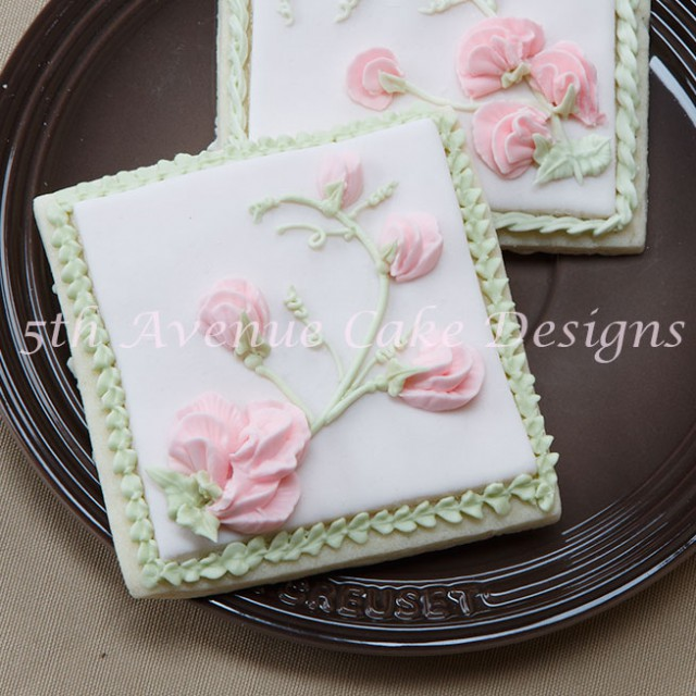 Learn how to pipe a spray of sweet peas on a cake, cupcake or cookie