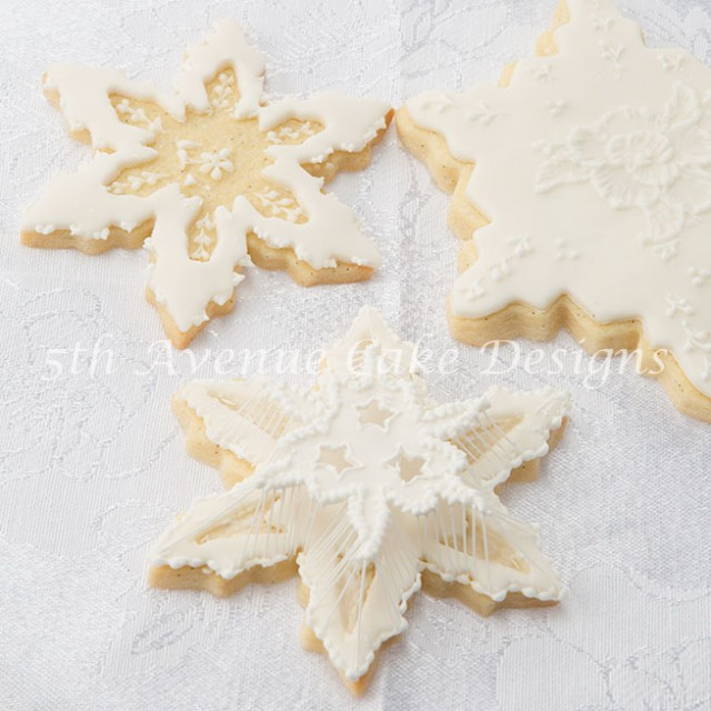 String-work piped on a snowflake cookie by Bobbie Noto