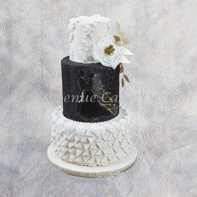 Black and white cake with fantasy wafer paper blossom